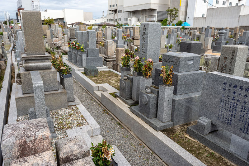 Panoramic view of cemetery and buildings in city