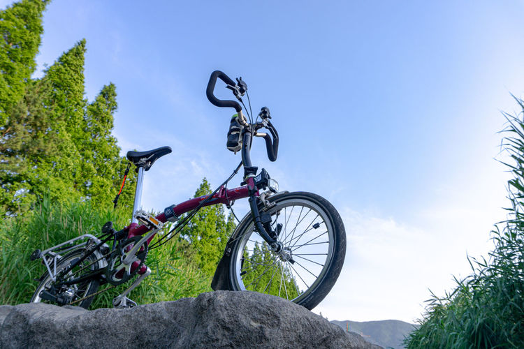 Low angle view of bicycle wheel against sky