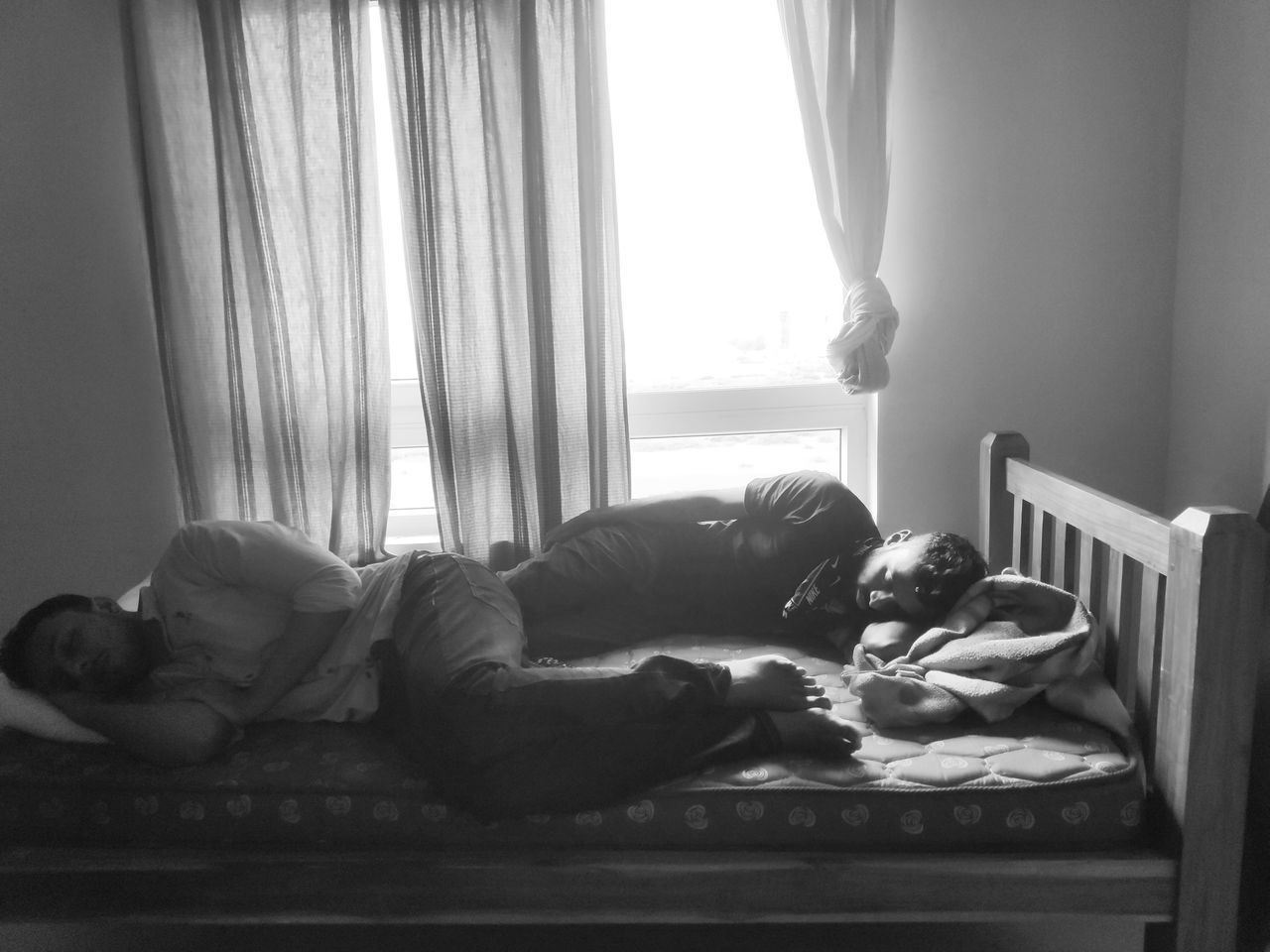WOMAN SLEEPING ON BED AT HOME