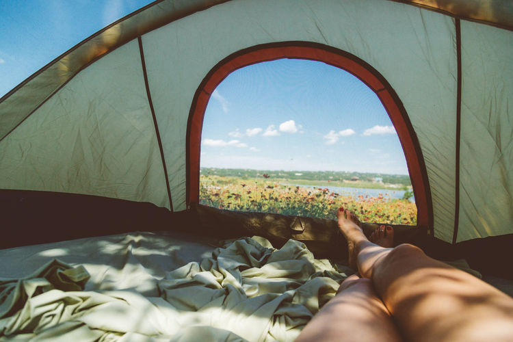 Camping Fé Nature Sunlight Woman Day Human Leg Inside Tent Legs Nature One Person Painted Toenails Peaceful Person In Nature Personal Perspective Relaxation Rewilding Shadow Window