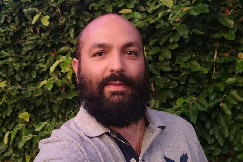 Portrait of bearded man against tree