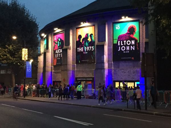 Apple Music Festival Illuminated Architecture Built Structure Night Building Exterior Group Of People Outdoors Person Commercial Sign