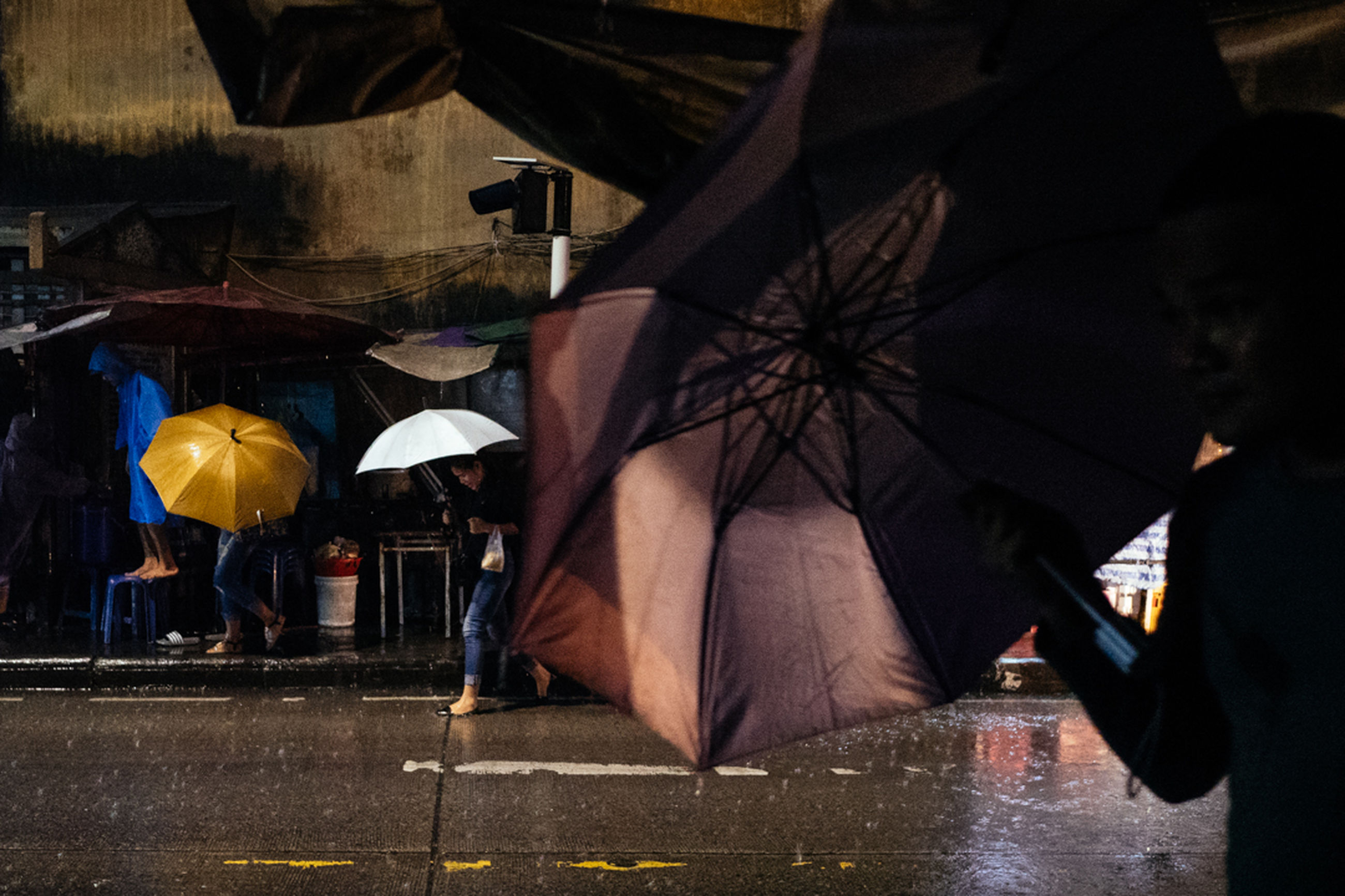 rain, wet, protection, rainy season, water, shelter, weather, below, real people, night, outdoors, under, men, low section, city, people