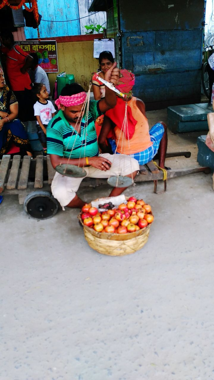 real people, fruit, market vendor, food and drink, traditional clothing, full length, sari, day, outdoors, food, lifestyles, women, men, healthy eating, one person, freshness, people