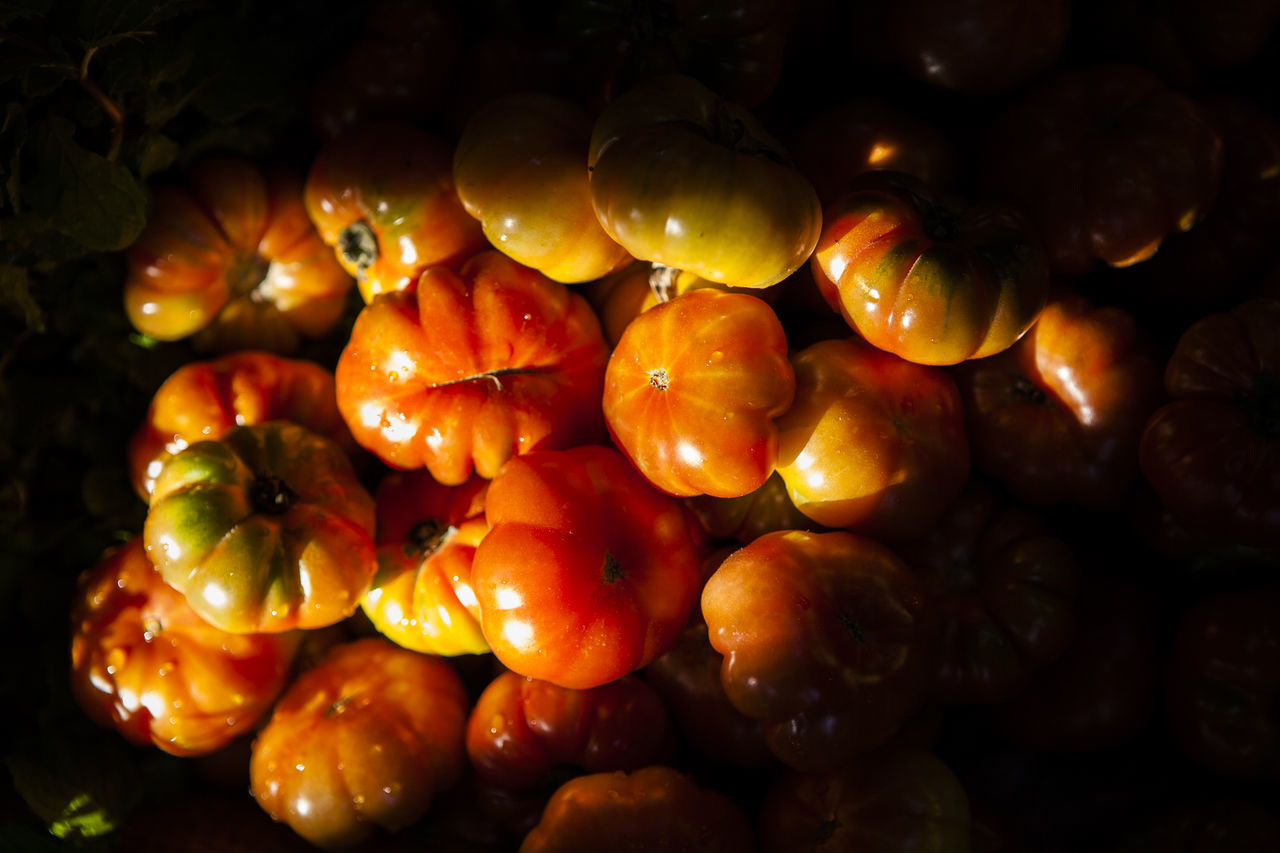 Stack of organic tomatoes on display