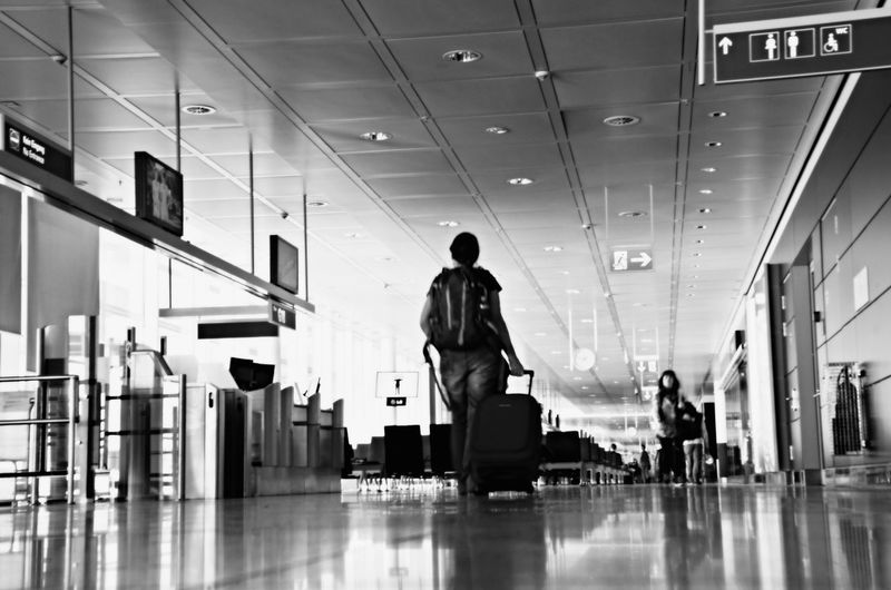 Where's he travelling to? Airportphotography Blackandwhite Blackandwhite Photography At The Airport