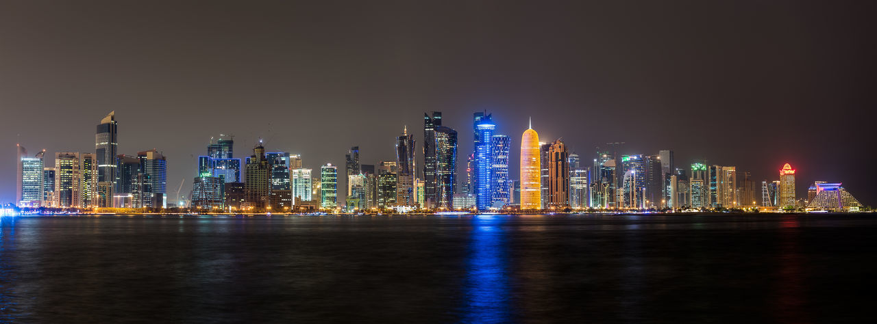 Doha skyline panorama Doha Panorama Panoramic Architecture Building Exterior Built Structure City Cityscape Downtown District Growth Illuminated Modern Night No People Outdoors Qatar Sea Sky Skyscraper Tall - High Tower Travel Destinations Urban Skyline Water Waterfront