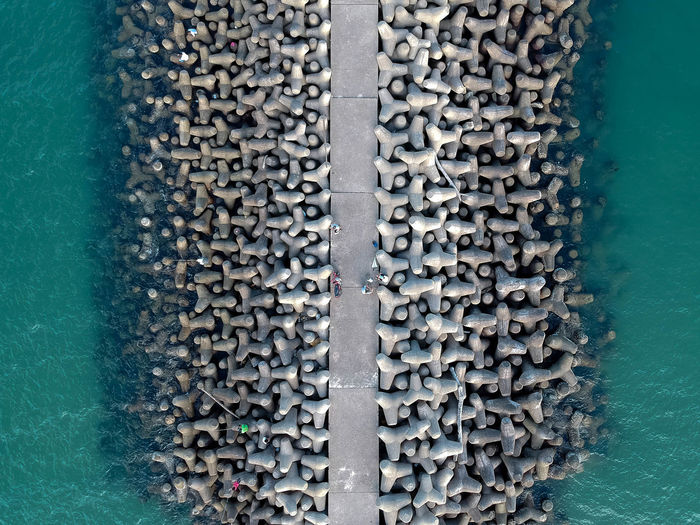 Aerial view of tetrapods at beach