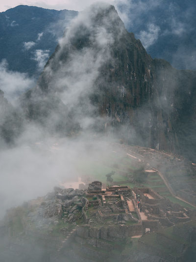 Aerial view of machu picchu ruins in foggy weather