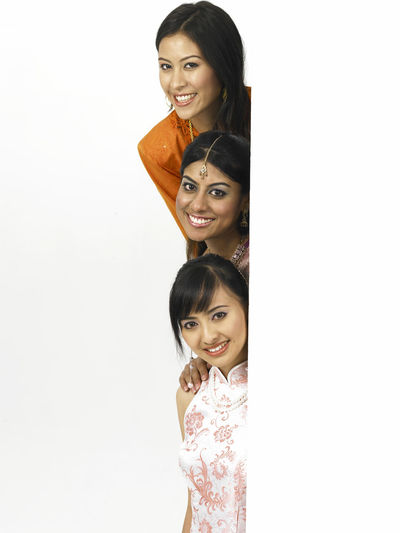 malaysia young woman in traditional costumes Friends Happiness In A Row Indian Stack Traditional Clothing Baju Kebaya Bubby Cheongsam Chinese Friendship Harmony Malay Ethnicity Malaysian Merdeka Mixed Race Multi Racial Racial Sari Smiling Together Togetherness United White Background Women