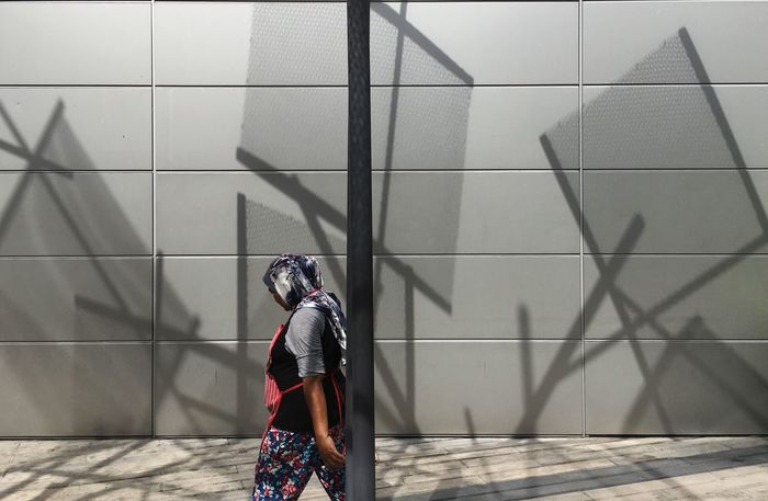 Women and shadow Real People One Person Shadow Built Structure Wall - Building Feature Sunlight Architecture Lifestyles Women Day Nature Flooring Leisure Activity Full Length Standing Warm Clothing Pattern Outdoors Clothing Tile EyeEmNewHere #urbanana: The Urban Playground