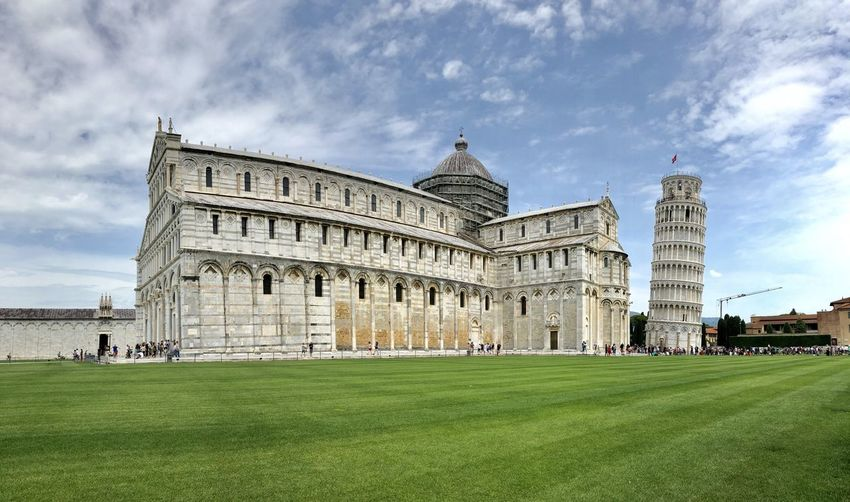 Pisa cathedral by lawn in city