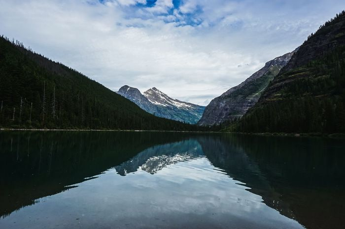 Beauty In Nature Cloud - Sky Day Glacier National Park Idyllic Lake Lake View Mirrorlake Mountain Mountain Range Nature No People Non-urban Scene Outdoors Plant Reflection Reflection Lake Scenics - Nature Sky Tranquil Scene Tranquility Tree Water Waterfront