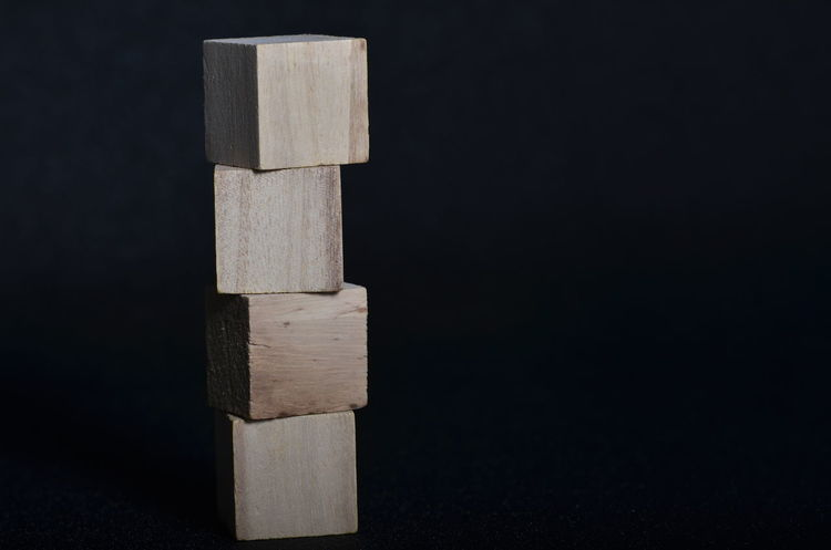 Stacked wooden block over black background Brain Game Cognitive Cube Development Puzzle  Sign Stack Structure Wooden Cube