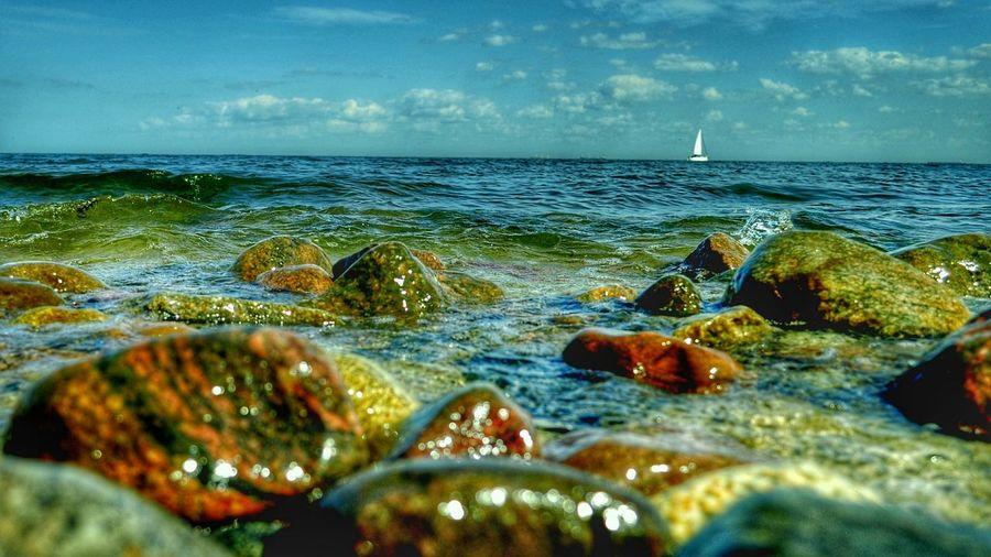 White Sail Sea And Sky Horizon Stones & Water