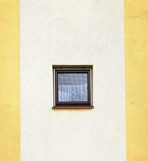 Full frame shot of yellow wall of building
