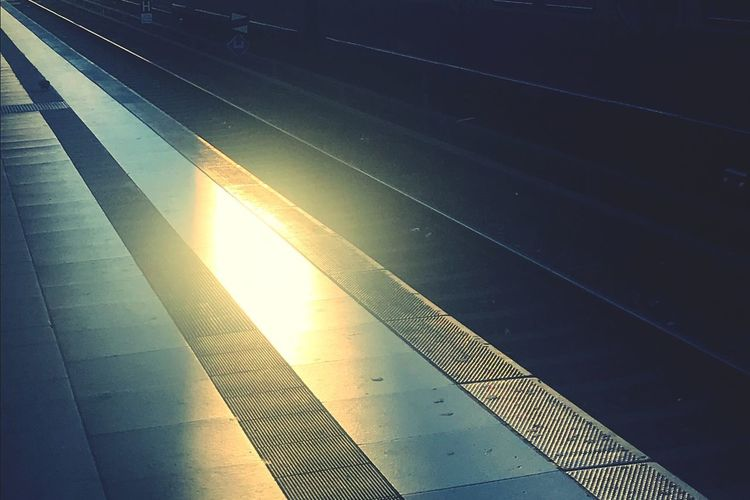 High angle view of railroad station platform at sunset