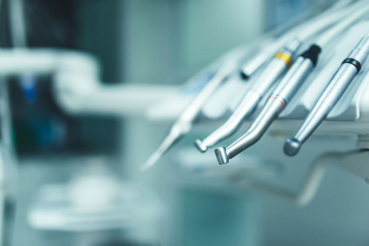 Close-up Focus On Foreground No People Indoors  Metal Healthcare And Medicine Selective Focus Silver Colored Medical Equipment Business Table Hospital Science Medical Supplies Group Of Objects Blue Surgery Still Life Office Handle Steel Alloy Dentistry Equipment Dental Equipment Dental Office