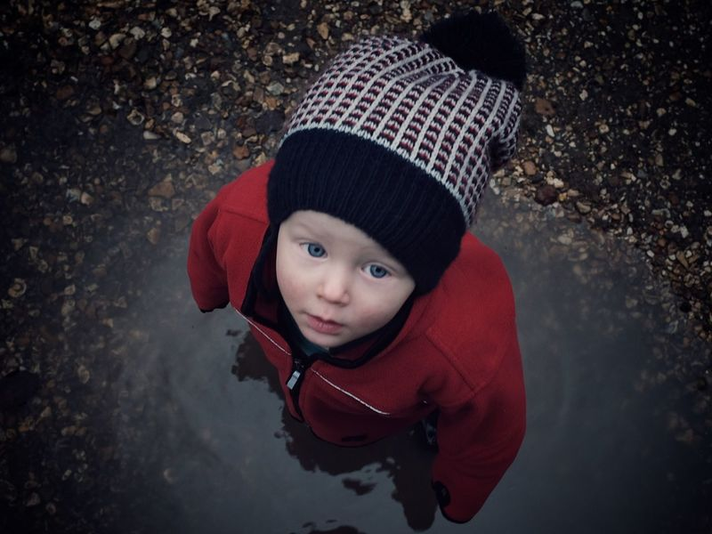 Puddle Jumping Shedfield, England, Childhood Knit Hat Warm Clothing Red One Person Portrait Outdoors Close-up Day People Fantasy