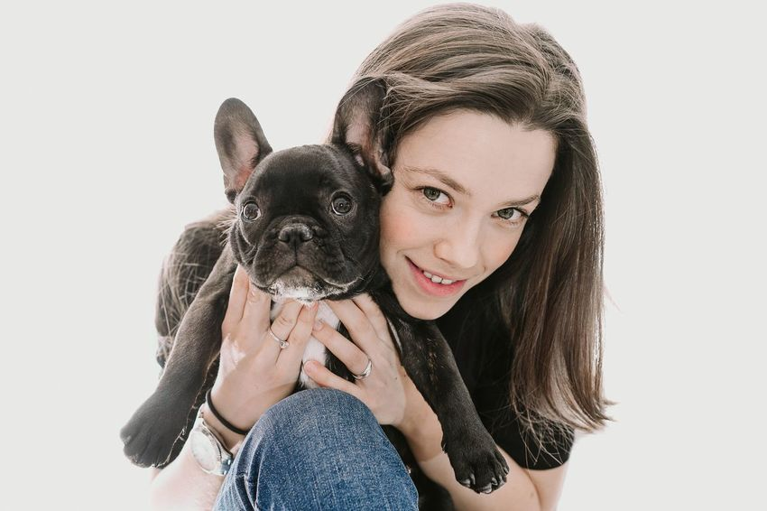 Smiling Smile One Person One Animal Frenchbulldog Frenchie Pet One Woman Only Woman Togetherness Bonding Friendship Pets Young Women Portrait Dog Looking At Camera White Background Studio Shot Happiness Holding Bulldog French Bulldog Pampered Pets Small Animal Face Purebred Dog Puppy