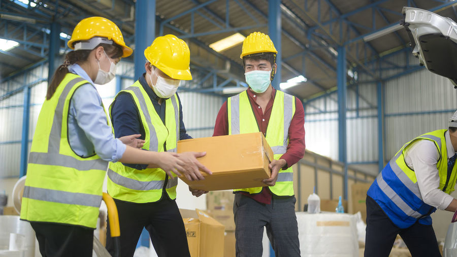 Group of people working in box