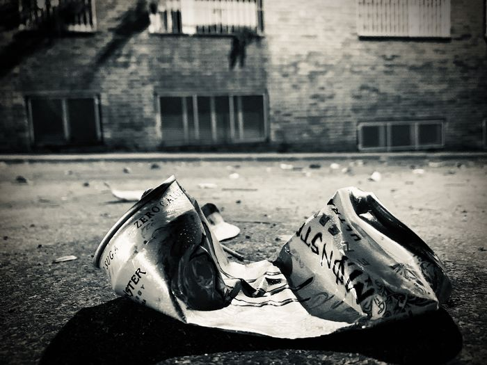 Close-up of abandoned shoes on footpath