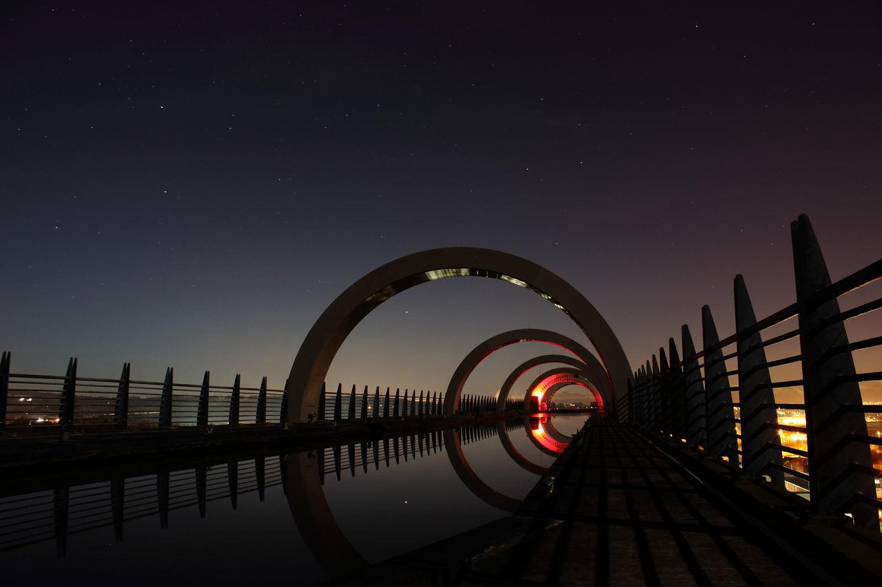 Falkirk wheel against sky at night