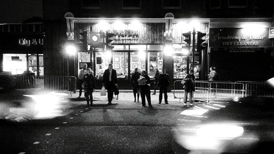 Men in illuminated city