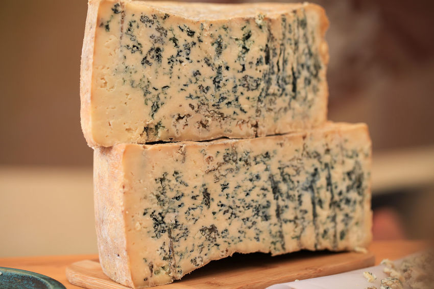 Sliced Gorgonzola or Roquefort cheese loaf Mold SLICE Stilton Aged Blue Cheese Close-up Dairy Product Day Fat Focus On Foreground Food Food And Drink French Freshness Gorgonzola Gourmet Half Healthy Eating Indoors  Milk Mould No People Ready-to-eat Roquefort