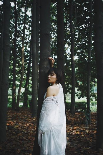 This Is My Skin Tree Forest Land Young Adult Plant Standing Young Women One Person Women Tree Trunk Trunk Three Quarter Length Growth Nature Adult WoodLand Leisure Activity Lifestyles Hairstyle Day Beautiful Woman (null)People Photography People Of EyeEm