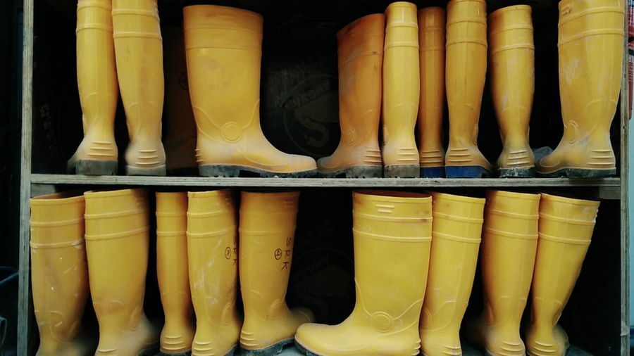 Rubber boots on shelf for sale