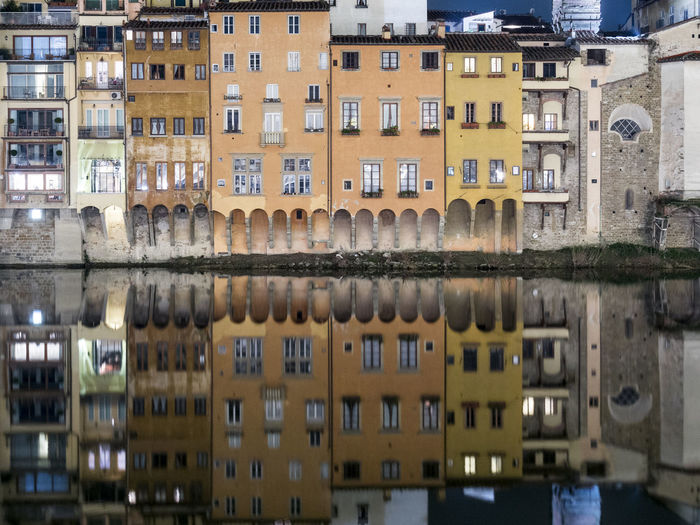 Reflection of buildings in river - florence