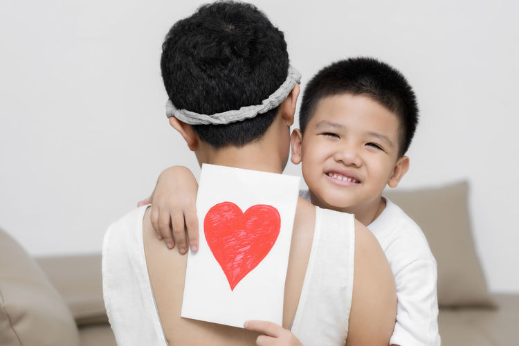 Portrait of father and son on heart shape