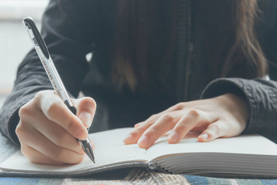 Adult Adults Only Author Close-up Day Desk Education Holding Human Body Part Human Hand Indoors  Junior High Learning Midsection Notebook One Person Paper Pen People Student Women Working Writing