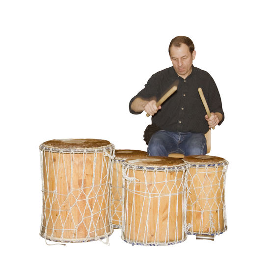man playing on the drums - african drum African Bongo Casual Clothing Communication Djembe Drum Drummer Drumming Drums Drumsticks Hitting Isolated Isolated On White Lifestyles Men Music Musical Instrument Musician One Man Only Percussion Rhythm Sitting Tradition White Background Wooden