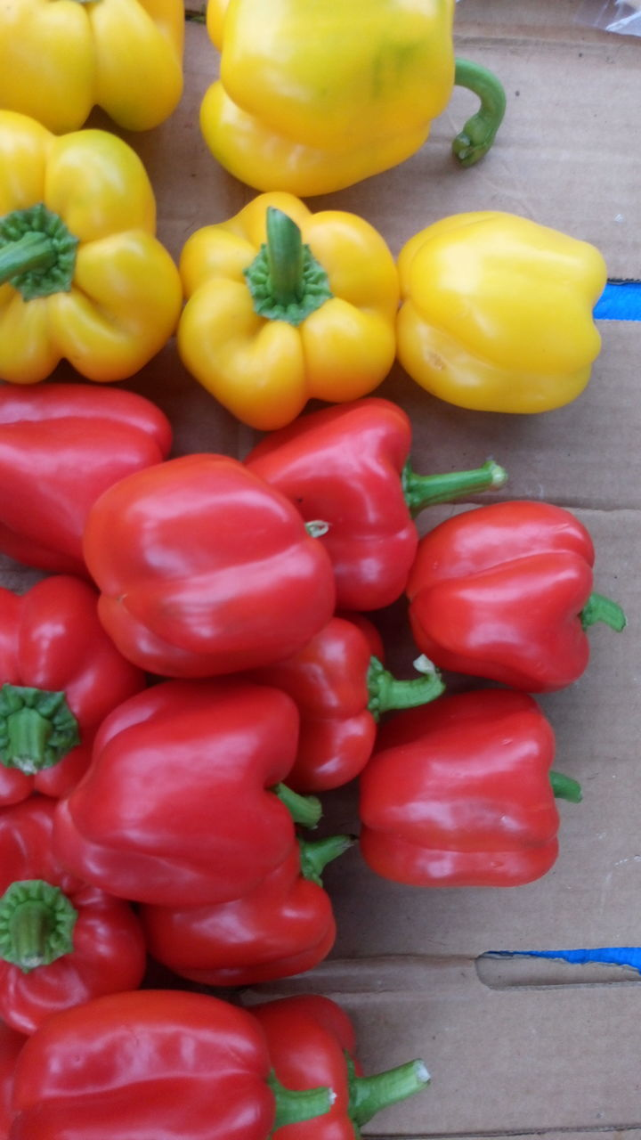 vegetable, bell pepper, food and drink, yellow bell pepper, food, for sale, red bell pepper, no people, healthy eating, freshness, market, retail, abundance, large group of objects, variation, red, choice, yellow, day, multi colored, close-up, outdoors