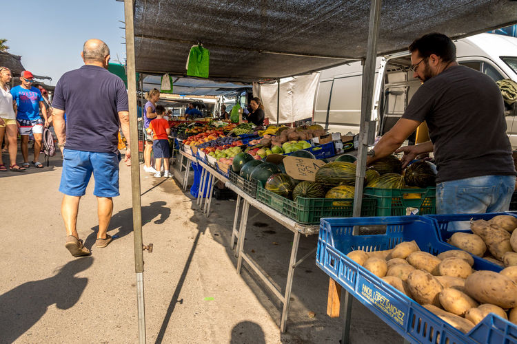 Roquetas De Mar SPAIN Almería Market Street Market Spanish Market Food Food And Drink Men Retail  Occupation Real People People Healthy Eating Market Stall Vegetable Freshness Standing Business Adult Incidental People Casual Clothing For Sale Buying Outdoors