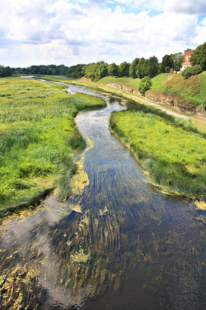 A taste of the Baltics Baltic Baltic Countries Baltic States Beauty In Nature Cloud - Sky Day Environment Flowing Flowing Water Grass Green Color Land Landscape Nature No People Non-urban Scene Outdoors Plant River Scenics - Nature Sky Stream - Flowing Water Tranquil Scene Tranquility Water