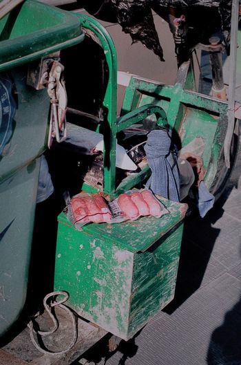 Old working on garbage bin