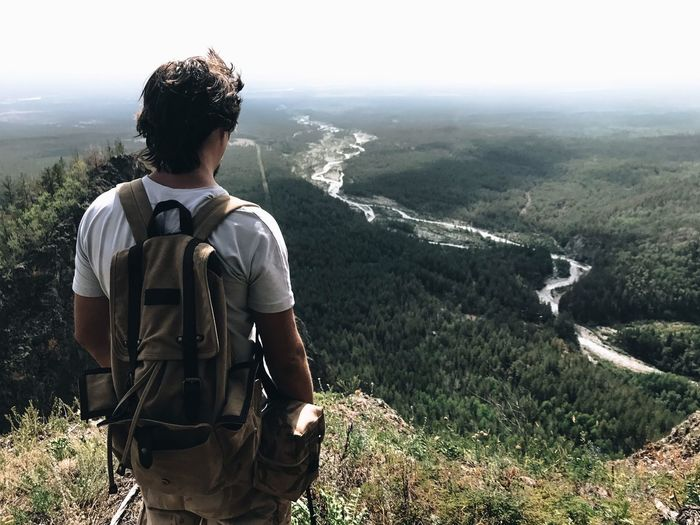 Mountain Nature One Person Backpack Landscape Looking At View Rear View Casual Clothing Real People Scenics Adventure Hiking Standing Leisure Activity Tranquil Scene Day Beauty In Nature Outdoors Mountain Range Tranquility Lost In The Landscape Second Acts My Best Travel Photo A New Beginning
