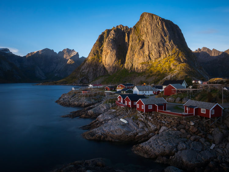 Beauty In Nature Clear Sky Cliff Day Hamnøy Lake Lofoten Lofoten Islands Mountain Mountain Range Nature No People Noryangjin Outdoors Physical Geography Reine Rock - Object Rock Formation Rocky Mountains Scenics Sky Tranquil Scene Tranquility Travel Destinations Water