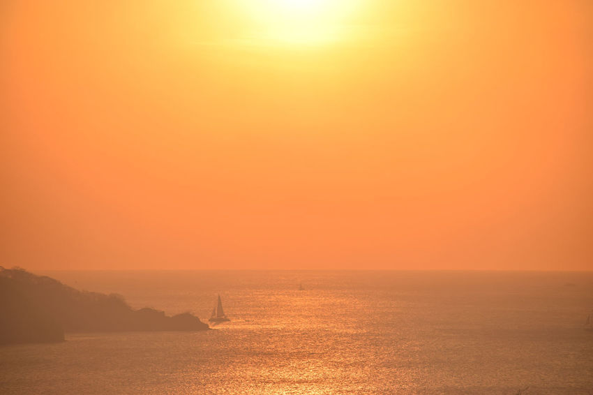 Sunset in Costa Rica Beauty In Nature Day Horizon Over Water Nature No People Orange Color Outdoors Sailboat In Sunset Scenics Sea Sky Sunset Tranquil Scene Tranquility Travel Destinations Water