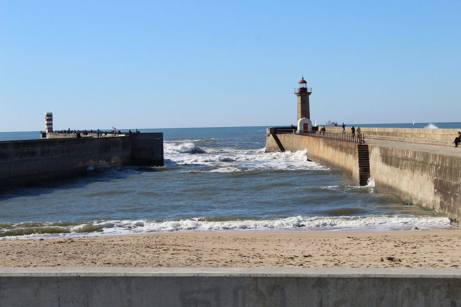 EyeEm Selects Lighthouse Protection Building Exterior Sea Sky Wave Travel Destinations Water Architecture Tranquil Scene Tranquility Day Clear Sky Vacations Blue Horizon Over Water No People Outdoors Nautical Equipment Beach Portugal 2018 Canon EOS 1300D