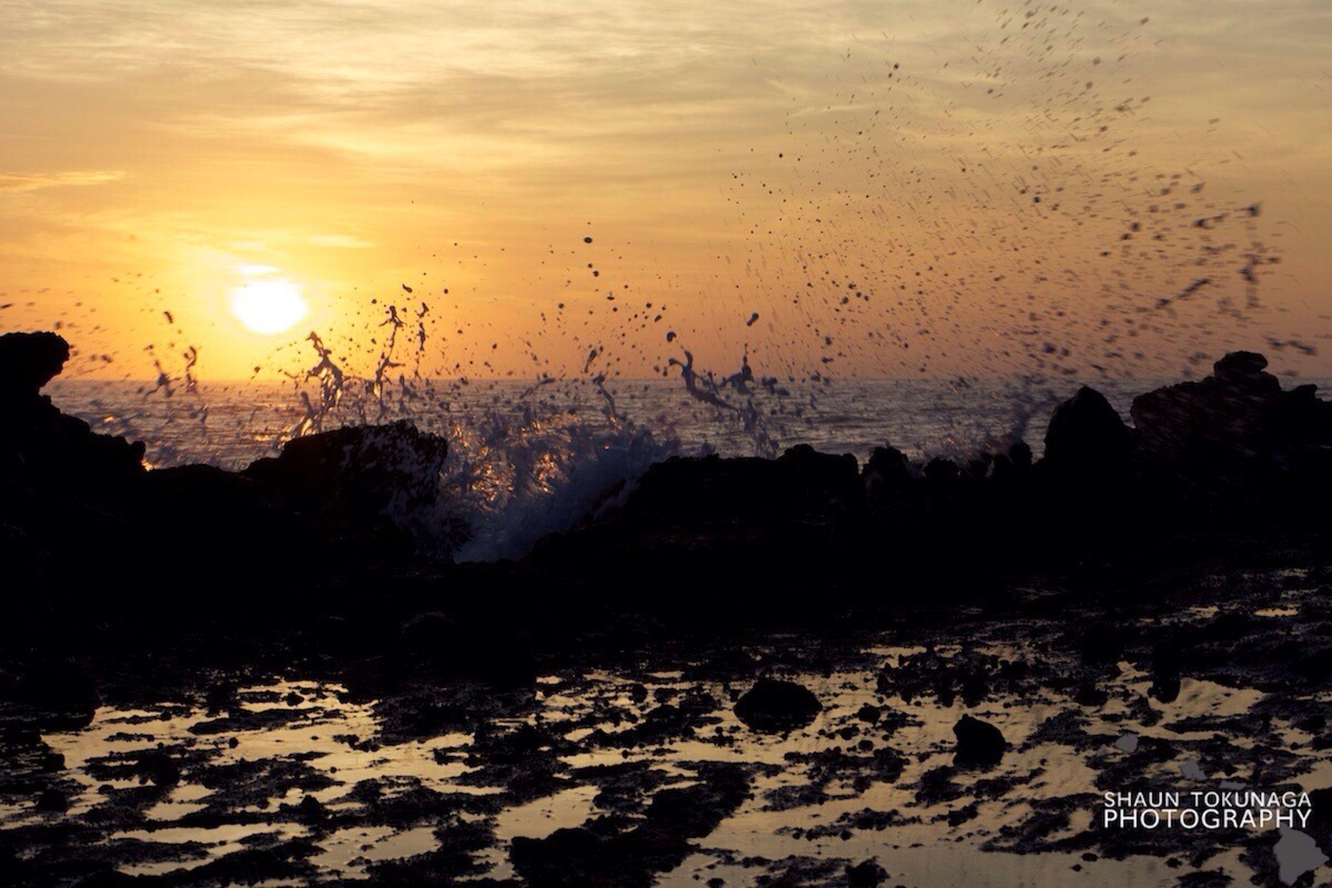 sunset, water, scenics, beauty in nature, tranquil scene, sky, sun, tranquility, nature, beach, rock - object, idyllic, sunlight, sea, outdoors, shore, sand, orange color, non-urban scene, cloud - sky