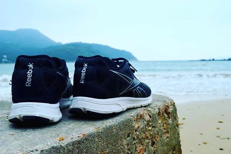 They are of no use at the beach.. Travel Traveldiary HongKong Overcast Mistymorning Sunday Travellove Theworldguru Clearwaterbay Beach Beachlove Instagramers Instagreat Flowers Instagood Instatravel Instapic Photgraphy Picoftheday Reebok Shoes Sands Waves Focus