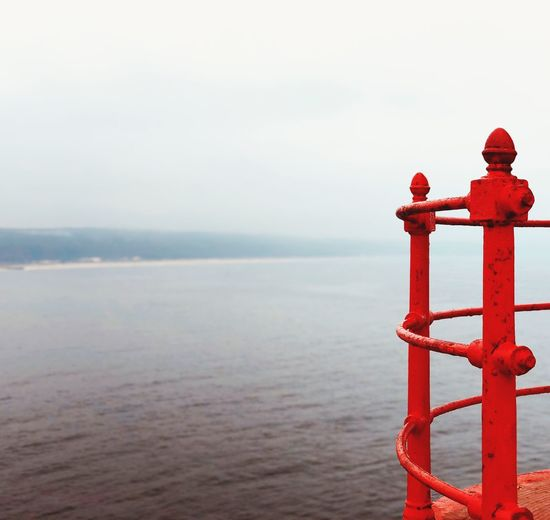 Water Sea Sky Scenics - Nature Beauty In Nature Nature Day Red Horizon Non-urban Scene No People Tranquility Outdoors Protection Horizon Over Water Metal Safety Security Tranquil Scene