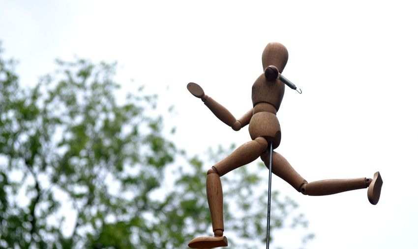 EyeEmNewHere Determination Running Blurred Treetop Imperfection Creates Determinatio Imperfection Is Nothing Persistance Run Away From Running Towards Success Undeterred Perseverance View From Below White Background Without Arm Wooden Mannequin