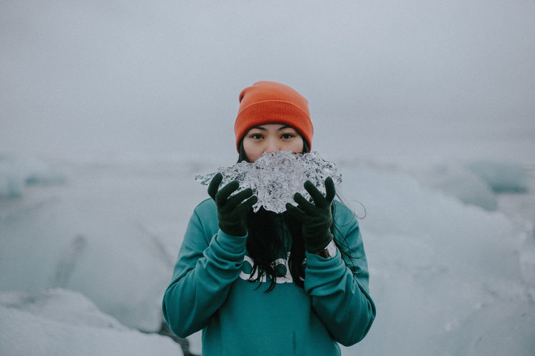 Portrait of girl with snow covered face