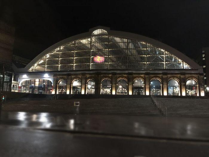 Illuminated train at night