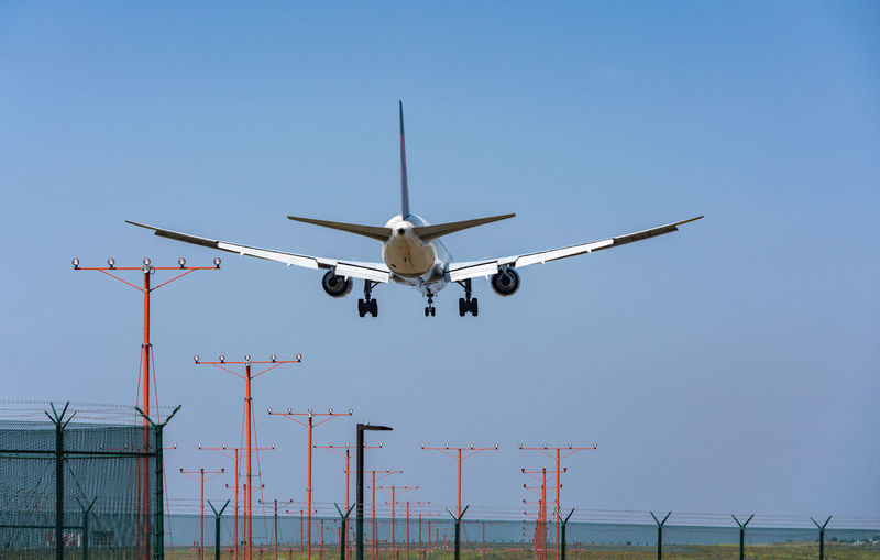Landing aircraft LAX Air Vehicle Airplane Sky Mode Of Transportation Transportation Flying Mid-air Clear Sky Travel Airport Blue Low Angle View Airport Runway Motion Day Commercial Airplane Landing - Touching Down No People Aerospace Industry 767 Boeing Boeing 767